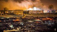Restes des cabanons du  camp après l'incendie