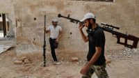 Des rebelles syriens, à Ain Tarma, dans la banlieue de Damas, le 20 juillet.