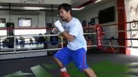 Le boxeur philippin Manny Pacquiao, portant des shorts et chaussures au logo Nike, pendant un entraînement à General Santos, sur l'île des Mindanao aux Philippines.